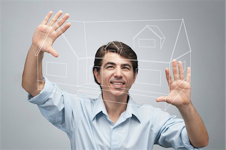 Man using advanced touch screen technology to view house plan Stock Photo - Premium Royalty-Free, Code: 632-06317058
