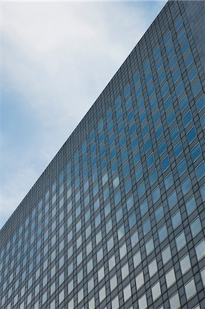 Facade of modern office building, low angle view Stock Photo - Premium Royalty-Free, Code: 632-06317091