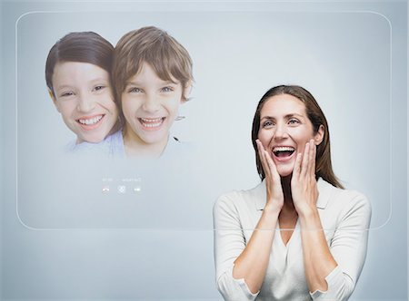 preteen touch - Woman doing video conference with children using advanced touch screen technology Stock Photo - Premium Royalty-Free, Code: 632-06317093