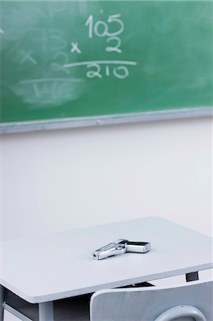 school desk - Handgun on desk in school classroom Stock Photo - Premium Royalty-Free, Code: 632-06317247
