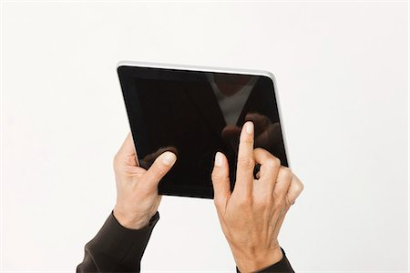 silhouette hand - Woman using digital tablet, cropped Stock Photo - Premium Royalty-Free, Code: 632-06317317