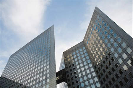 Facade of modern office buildings against sky, low angle view Stock Photo - Premium Royalty-Free, Code: 632-06317430