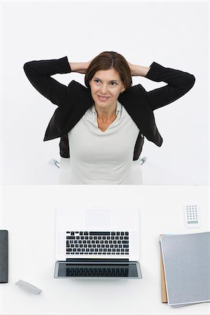 Businesswoman relaxing at desk, high angle view Stock Photo - Premium Royalty-Free, Code: 632-06317464