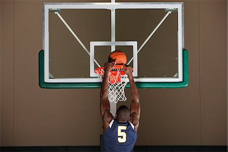 Basketball player making a basket Stock Photo - Premium Royalty-Free, Code: 632-06317486