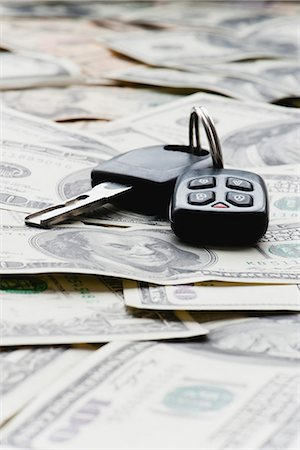 Car key on pile of one hundred dollar bills Stock Photo - Premium Royalty-Free, Code: 632-06317496