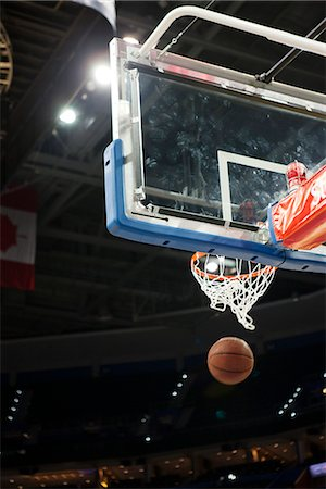 Basketball falling through hoop Stock Photo - Premium Royalty-Free, Code: 632-06317515