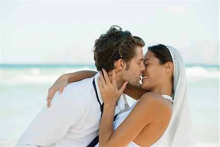 Bride and groom kissing at the beach Stock Photo - Premium Royalty-Free, Code: 632-06317567