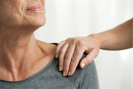 Comforting hand on senior woman's shoulder, cropped Stock Photo - Premium Royalty-Free, Code: 632-06317584