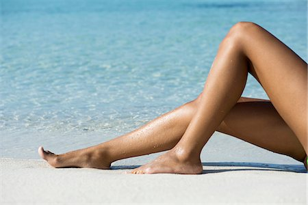 Woman's legs on beach, low section Stock Photo - Premium Royalty-Free, Code: 632-06317587