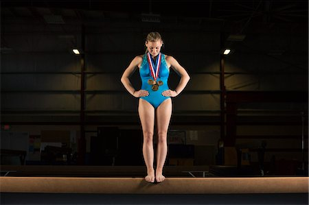 feet gymnast - Gymnast with medals standing on balance beam Stock Photo - Premium Royalty-Free, Code: 632-06317620