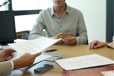 Business associates discussing contract, cropped Stock Photo - Premium Royalty-Free, Code: 632-06317639