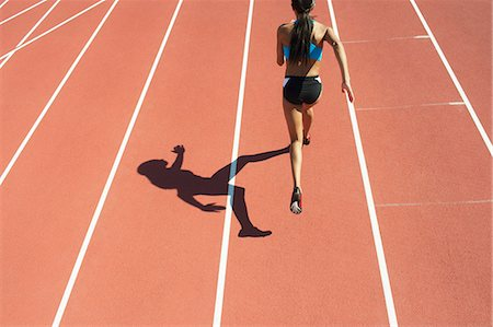 race track (people) - Female athlete running on track Stock Photo - Premium Royalty-Free, Code: 632-06317673