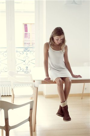 preteen beauty - Girl sitting on table, portrait Stock Photo - Premium Royalty-Free, Code: 632-06317711