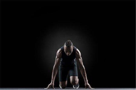 runner (male) - Runner at starting line Stock Photo - Premium Royalty-Free, Code: 632-06317757
