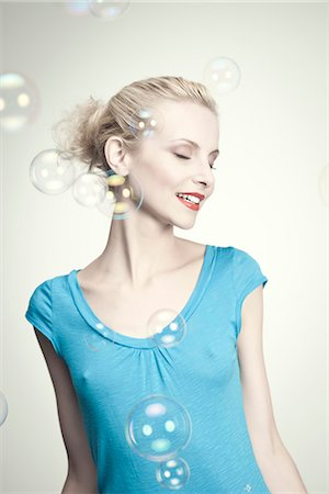 Young woman surrounded by bubbles Stock Photo - Premium Royalty-Free, Code: 632-06317793