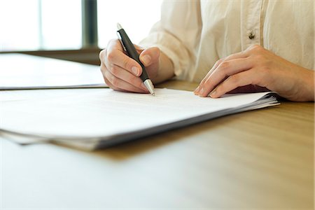Person signing paperwork Stock Photo - Premium Royalty-Free, Code: 632-06317868