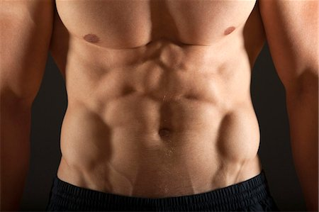 Barechested body builder's abdomen, close-up Stock Photo - Premium Royalty-Free, Code: 632-06317980