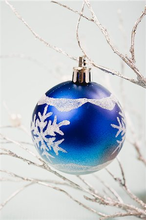 Blue bauble hanging from silver branches Stock Photo - Premium Royalty-Free, Code: 632-06354136
