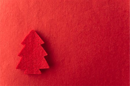 festive - Christmas tree shape on red background Stock Photo - Premium Royalty-Free, Code: 632-06354221