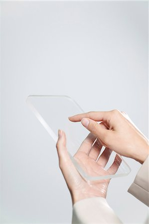 Woman's hands holding transparent digital tablet Stock Photo - Premium Royalty-Free, Code: 632-06354438
