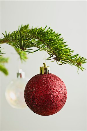 Christmas baubles hanging from Christmas tree Stock Photo - Premium Royalty-Free, Code: 632-06353970