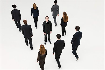 different - Businessman standing in midst of other anonymously dressed business professionals Stock Photo - Premium Royalty-Free, Code: 632-06404608