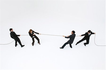 Business professionals playing tug-of-war Stock Photo - Premium Royalty-Free, Code: 632-06404618