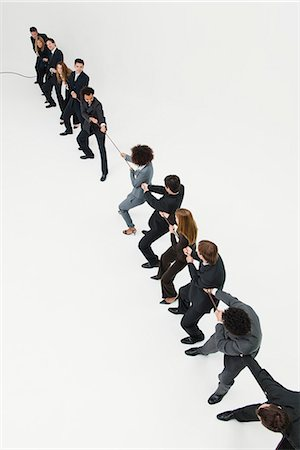 pulling - Business professionals in tug-of-war match Stock Photo - Premium Royalty-Free, Code: 632-06404622