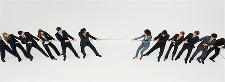 pulling - Business professionals in tug-of-war match Stock Photo - Premium Royalty-Free, Code: 632-06404638