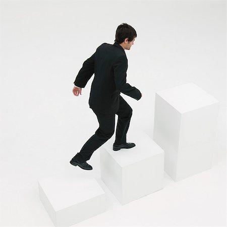 Businessman ascending steps Stock Photo - Premium Royalty-Free, Code: 632-06404640