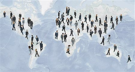 Large group of businesspeople walking on world map Stock Photo - Premium Royalty-Free, Code: 632-06404695