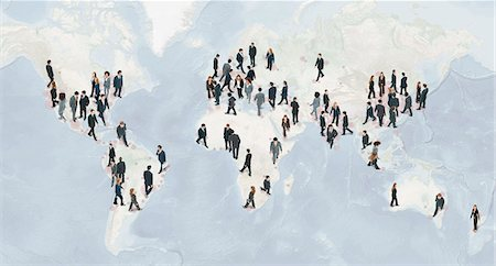 Large group of businesspeople walking on world map Stock Photo - Premium Royalty-Free, Code: 632-06404698