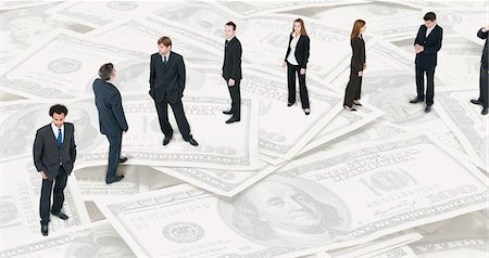 Executives lined up on image of one-hundred dollar bills Stock Photo - Premium Royalty-Free, Code: 632-06404703