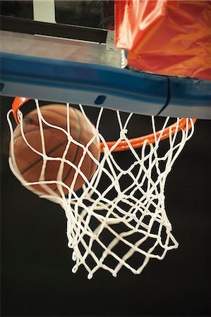 Basketball going through hoop Stock Photo - Premium Royalty-Free, Code: 632-06779110