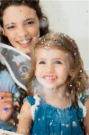 family image and confetti - Girl looking at falling confetti Stock Photo - Premium Royalty-Free, Code: 632-06779299