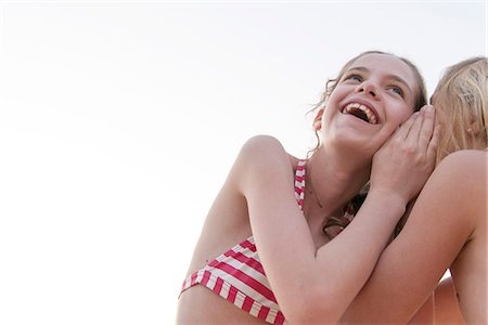 Friends telling secrets Stock Photo - Premium Royalty-Free, Code: 632-07161407
