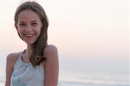 Preteen girl at beach, portrait Stock Photo - Premium Royalty-Free, Code: 632-07161575