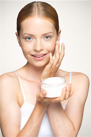 prevention - Young woman moisturizing face Stock Photo - Premium Royalty-Free, Code: 632-07494933