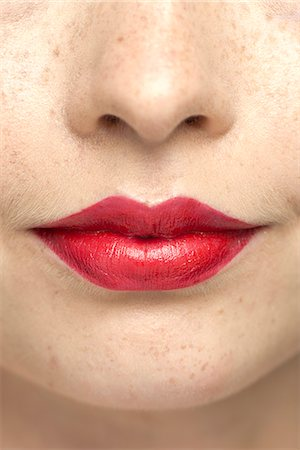Young woman wearing bright red lipstick, portrait Stock Photo - Premium Royalty-Free, Code: 632-07494969