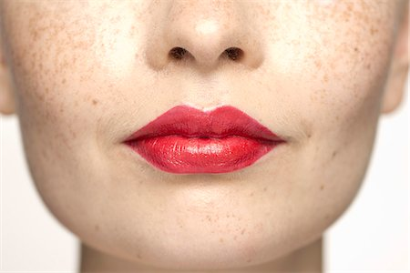 Young woman wearing bright red lipstick, portrait Stock Photo - Premium Royalty-Free, Code: 632-07494972