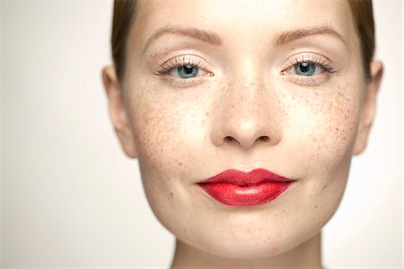 Young woman wearing bright red lipstick, portrait Stock Photo - Premium Royalty-Free, Code: 632-07494973