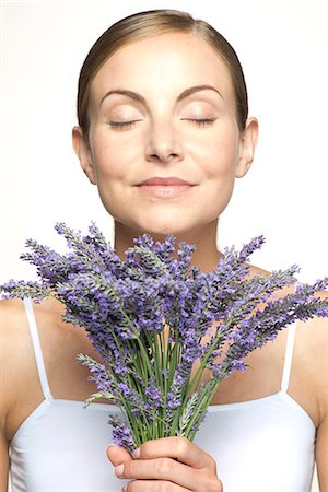 smelling - Woman smelling bouquet of fresh lavender with eyes closed Stock Photo - Premium Royalty-Free, Code: 632-07495009