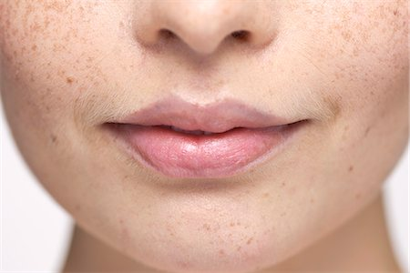 Close-up of young woman's face and lips Stock Photo - Premium Royalty-Free, Code: 632-07495087