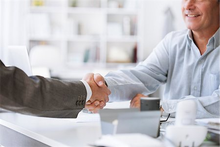 Businessmen shaking hands Stock Photo - Premium Royalty-Free, Code: 632-07539897