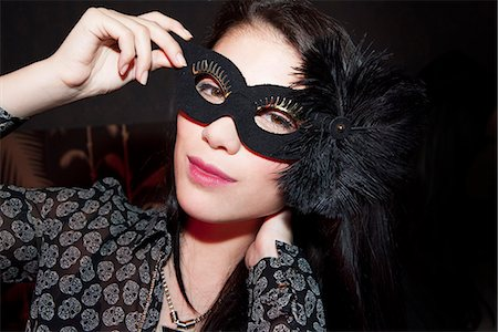 festive - Woman wearing party mask, portrait Stock Photo - Premium Royalty-Free, Code: 632-07539906