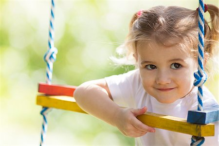 Little girl playing outdoors Stock Photo - Premium Royalty-Free, Code: 632-07539938