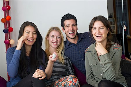 Friends watching movie at home together Stock Photo - Premium Royalty-Free, Code: 632-07539953