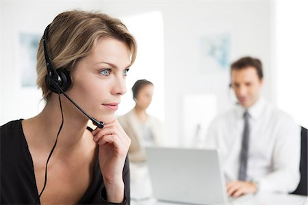 Businesswoman wearing headset working in office Stock Photo - Premium Royalty-Free, Code: 632-07539998