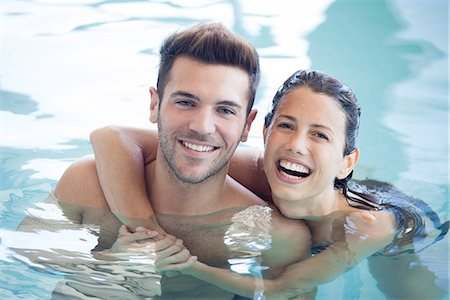 swimming pool water - Young couple in pool together, portrait Stock Photo - Premium Royalty-Free, Code: 632-07674453
