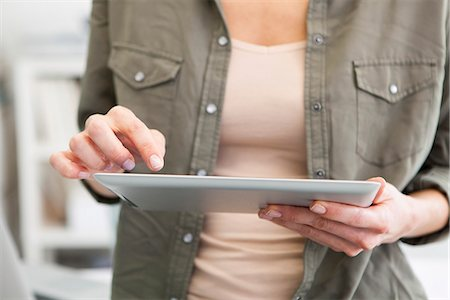 device - Woman using digital tablet, cropped Stock Photo - Premium Royalty-Free, Code: 632-07674464